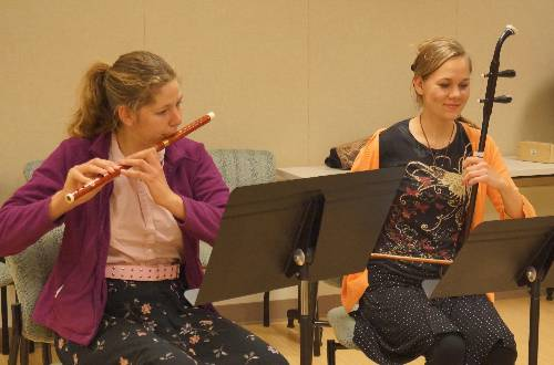 students playing dizi (flute) and erhu (fiddle)