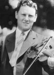 Albert Gore, Sr. playing a fiddle