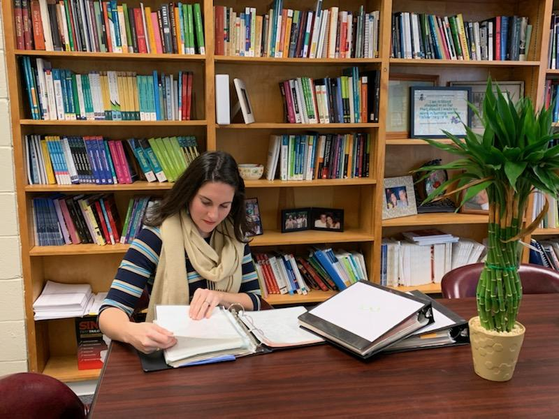Faculty and Graduate Students Work with Archival Documents